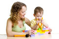 Child and mom play with block toys boy Royalty Free Stock Image