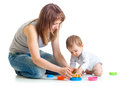 Child and mom play with block toys boy Royalty Free Stock Photo