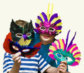 Child and mother in carnival masks Stock Photo
