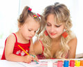 Child with mother painting indoors Stock Photo