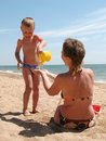 Child and mother play on breach Stock Photography