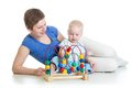 Child and mother play with educational toy boy playing Stock Images