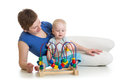 Child and mother play with educational toy