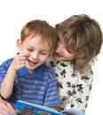 Child with mother read the book Royalty Free Stock Images