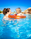 Child with mother in swimming pool Royalty Free Stock Photography