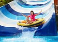 Child mother water slide aquapark summer holiday Royalty Free Stock Photography