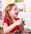 Child mould from clay in play room. Royalty Free Stock Photo