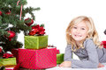 Child next to a christmas tree with presents with and isolated white background Royalty Free Stock Photo