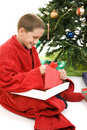 Child Opening Christmas Gift Stock Photo
