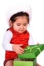 Child opening christmas gift. Royalty Free Stock Photo