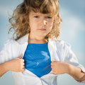 Child opening his shirt like a superhero girl power and feminism concept Royalty Free Stock Image