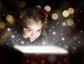 Child opening a magic gift box Royalty Free Stock Photo