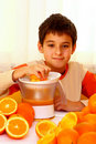 Child with oranges Royalty Free Stock Images
