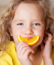 Child with oranges Stock Image