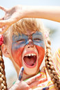 Child  with paint on face and hand. Royalty Free Stock Images