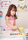 Child paint picture in preschool. Stock Photo