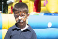 Child with painted face tiger paint boy on children s holiday Stock Image