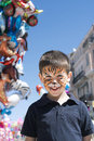 Child with painted face tiger paint boy on children s holiday Royalty Free Stock Images