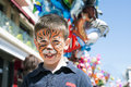 Child with painted face tiger paint boy on children s holiday Stock Photos