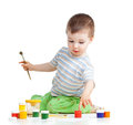 Child painting with brush boy Stock Photos