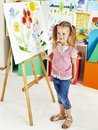 Child painting at easel in art class Royalty Free Stock Photo