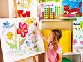 Child painting at easel in art class Royalty Free Stock Photography