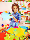 Child painting at easel little girl in school education Stock Photography