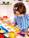 Child painting at easel little girl in school education Royalty Free Stock Images