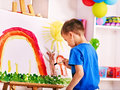 Child painting at easel in school education Stock Photography