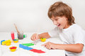 Child painting happy boy with colors Stock Image