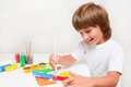 Child painting happy boy with colors Royalty Free Stock Photos