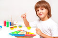 Child painting happy boy with colors Stock Photography