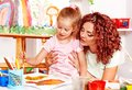 Child painting with mum. Royalty Free Stock Photos