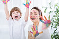 Child painting with mum Royalty Free Stock Photo