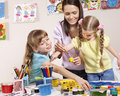 Child painting in preschool. Royalty Free Stock Photo