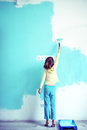 Child painting the wall Royalty Free Stock Photo