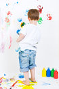 Child painting on the wall Royalty Free Stock Image