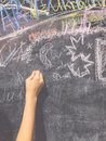 A child paints by chalk on a school board Royalty Free Stock Photo