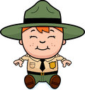 Child park ranger sitting a cartoon illustration of a boy and smiling Royalty Free Stock Image