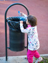 Child participate in recycling in the park in spring time Royalty Free Stock Photo