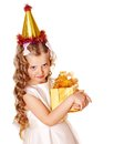 Child in party hat with gold gift box on birthday isolated Stock Photo