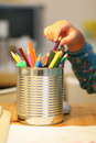 Child picks a pencil Royalty Free Stock Images