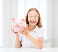 Child with piggy bank education school and money saving concept Stock Photo