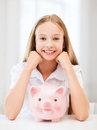Child with piggy bank education school and money saving concept Royalty Free Stock Images