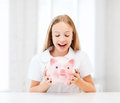 Child with piggy bank education school and money saving concept Stock Image