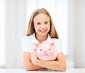 Child with piggy bank education school and money saving concept Royalty Free Stock Image