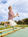 Child plaing golf. Child golfer. Royalty Free Stock Photography