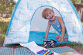 Child plaing in toy tent Stock Photo