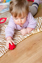 Child play on floor Royalty Free Stock Photo