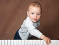 Child play music on piano keyboard portrait of little baby black and white Royalty Free Stock Image